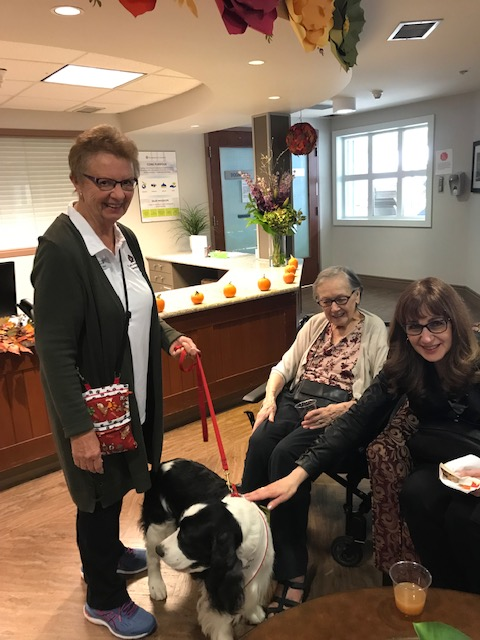 molly the therapy dog with owner Gail and residents at GSV!