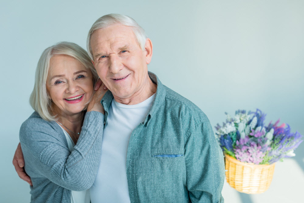 a happy couple living together in their retirement community